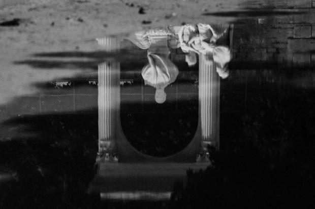 Puddle reflection/Jardin des Tuilleries, Paris, by ©Gonzalo Bénard