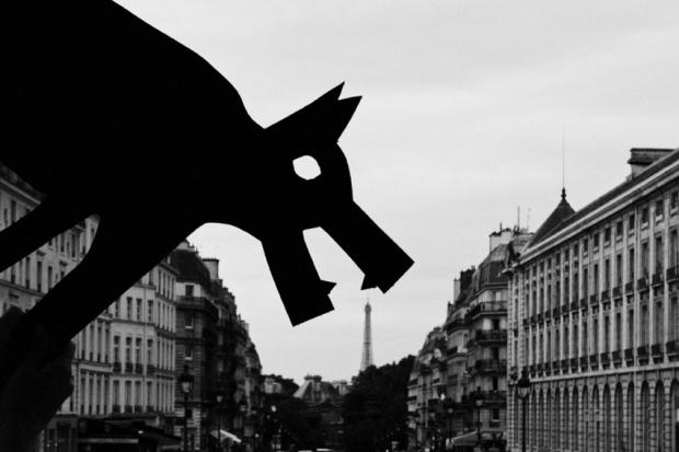 Dog eating Eiffel Tower, Paris, by ©Gonzalo Bénard