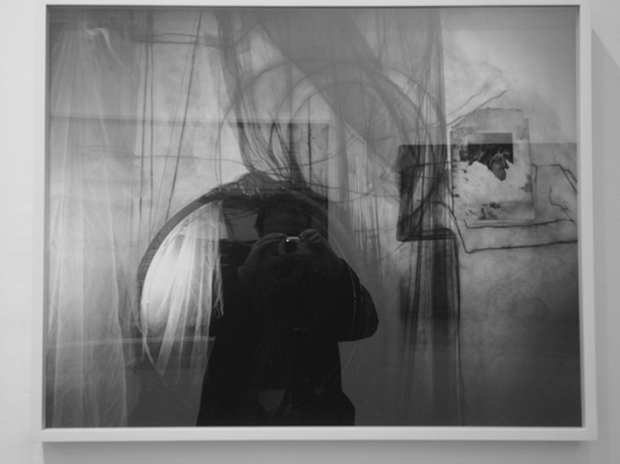 self portrait reflected on Janice Guy at Yancey Richardson Gallery