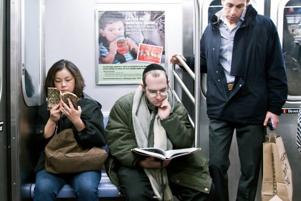 "She reads: ""Nekoben"" by Junko Ohyama - He reads: ""Halachos of Pesach"" by Shimon D. Eider"