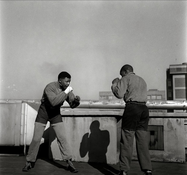 Young Nelson Mandela boxing on a roof top in Johannesburg during a break from the Treason Trial in 1957. photo by Bob Gosani