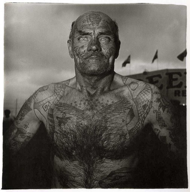 The wonderful tattooed man at a carnival in Maryland, 1970, by Diane Arbus