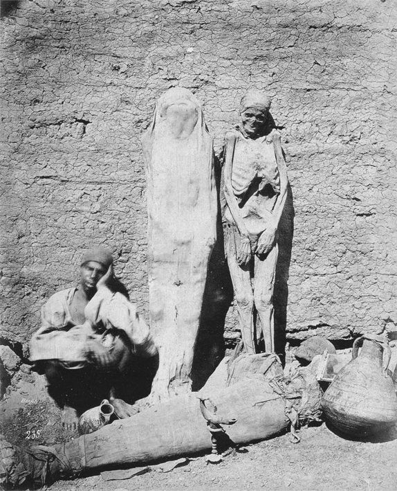Man selling mummies in Egypt, 1875.