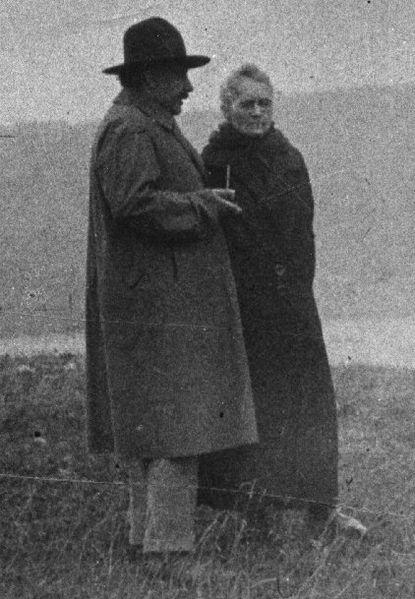 Marie Curie with Albert Einstein, by unknown photographer